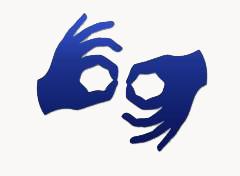 Ikona z rękoma przekierowywująca do tłumacza online języka migowego.